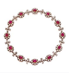 GOLD, SILVER, RUBY AND DIAMOND NECKLACE, CIRCA 1875.    The slightly graduated necklace of floral design set with cushion-shaped and oval rubies weighing approximately 16.50 carats, accented by old mine diamonds weighing approximately 37.00 carats, length 16 inches.  With fitted box signed S.J. Phillips.