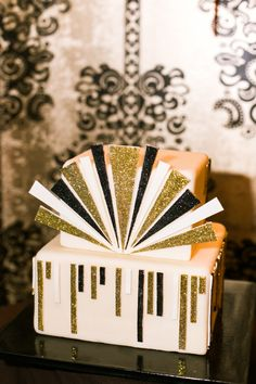 Art deco cake at a restaurant reception at The Barrymore | Sarah and Scott's Vintage 1920s Vegas Speakeasy Themed Wedding by @Gaby Jeter Photography | Little Vegas Wedding