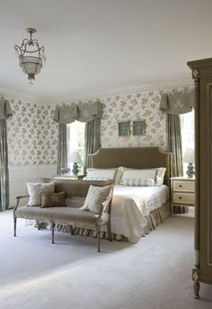 The main floor guest #suite in this Clifton, VA home was papered by designer Annette Hannon in a Farrow & Ball