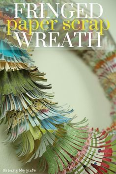 Have a lot of paper scraps? Use up those scraps and create this beautiful wreath to hang on your wall. Step by step and video tutorials show you how.
