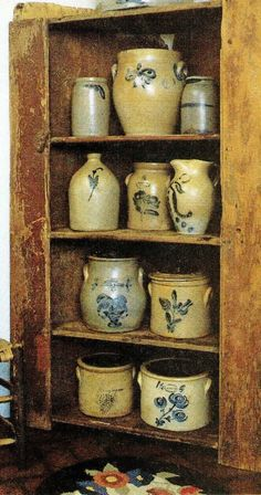 shelves filled with stoneware crocks and jugs