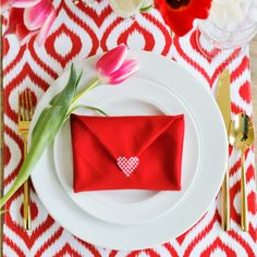 Surprise your loved ones at the table on Valentine's Day. This easy Valentine Envelope Napkin Fold Tutorial (with video) is meaningful, fun and fabulous!