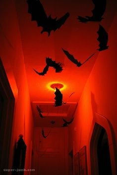 Bats and red lighting make for an awesome home haunt ceiling