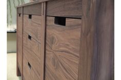 Makes perfect sense.  Of course.  Absolutely Danish, but custom made in Long Island, NY.  The No. 30 design solid walnut or rift oak kitchen cabinetry has rectangular cut outs in lieu of pulls.  No pinched fingers, no wobbly hardware, simple aesthetic.  Also Danish:  natural oil finish to allow wood's real color to do its thing. No need to cover up bad workmanship, beautiful joinery readily visible. Yes please. Bornholm Kitchen.