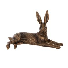 Our decorative Lying golden hare is lounging about in the sun on a warm summers afternoon in the garden. A perfect addition to the garden, it can also be used a decorative accessory indoors.