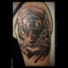 Upper arm tattoos for black women   Photo by (samharrison_the_creator) on Instagram   #tiger #tigertattoo #realistictattoo #bngink #blackandwhitetattoo #upperarmtattoo #tattoouk #tattoo #tattoos #tattooed #tattoolover #tattooculture #ink #inked #inkmag #inklover #inkmaster #inkart #inkmania #sheffielduk #sheffieldtattoo