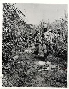 """Merrill's Marauders"" pass fallen Japanese troops in Burma"