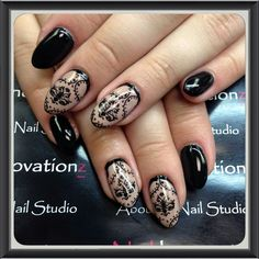 Classic black and nude gel nails, with nail stamping to add some elegant art work