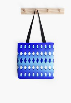 Penguins form an Army in their icy home Antarctica and plan their World Domination. Tote Bag with Vivid Blue design of Penguins a perfect gift for all Penguin Lovers  #penguin #penguins #antarctica #ice #snow #blue #online #shopping #kids #family #cute #funny #animals #birds #armyofpenguins #letitsnow #xmas #baby #baby #shower #christmas #giftsforhim #giftsforher #kids  #home #decor #homegifts #home #penguinlove #penguinlovers, #popart  #popular #tshirtdesign #tshirtfashion