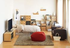 Not crazy about these colours, but like the organisational elements -- the bookshelves, the underbed storage