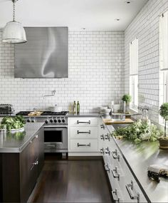 love the subway tiles in this kitchen + all that white and green, via gingham and watercolors