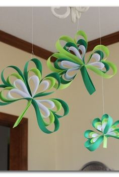 shamrocks made out of paper - there's a tutorial on how to make them - -Paper Strip Shamrocks ~ Sugar Bee Crafts