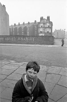 """class-struggle-anarchism: """" Liverpool, 1969 A young boy on the corner of a Liverpool 8 street Graffiti reads """"WHY VOTE? Liverpool England, Liverpool Life, Liverpool History, Liverpool Waterfront, Liverpool Docks, Old Pictures, Old Photos, Revolution, Urban Intervention"""