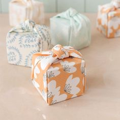 Wrap up your wedding favors and treats in a swatch of pretty fabric using our chic knotted technique.