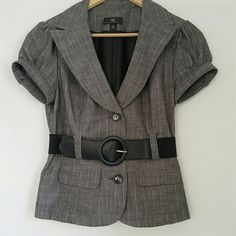 """IZ BYER Grey Pinstripe Cap Sleeve Jacket Blazer This adorable blazer is a wardrobe ESSENTIAL! It's light grey color makes it color coordinate year round! Classy pinstripe with 2 pockets in the front and a stretchy wide elastic belt included. Beautiful lapel design and adorable puff cap sleeves with button detail. Junior sizing runs small. Underarm to Underarm: 17"""" Length: 20"""" Waist: 15"""" (at belt). Sleeve Length: 5.5"""" with a 6"""" Armhole Opening Iz Byer Jackets & Coats Blazers"""