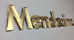 """Mendocino pastelice metalic gold and artsigns custom finish ½"""" thick material flay on the wall corporate office signage  www.artsigns.com"""