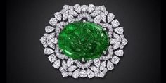 A rare 122.47ct Emerald, intricately hand carved and set within an exceptional #GraffDiamonds brooch