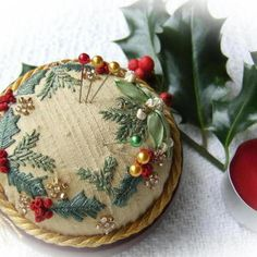 """Holly and Mistletoe Gold Jewel pincushion PDF pattern by Lorna Bateman - Available on Folksy - Seems to be the """"British Eysy""""... - http://folksy.com/items/2587393-Holly-and-Mistletoe-Gold-Jewel-pincushion-kit"""
