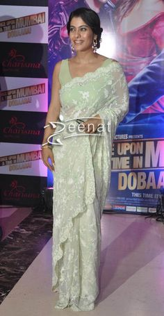 Kajol in net saree at once upon a time in mumbai launch. Green Net saree paired with a designer saree blouse having V-neck while the saree is plain with no embellishments, a perfect way to look awesome in simple saree.