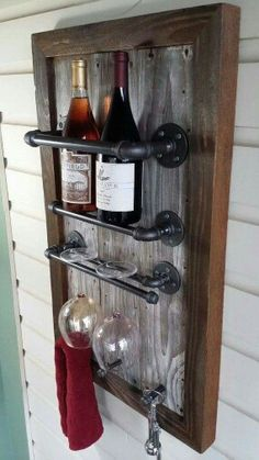 A pipe wooden wine shelf -- made wider for at least 4 bottles