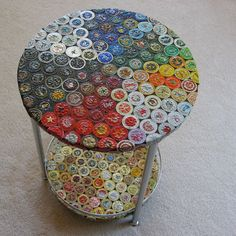 Here's a double-decker table featuring a couple hundred #recycled hand-flattened bottle caps from all over the world