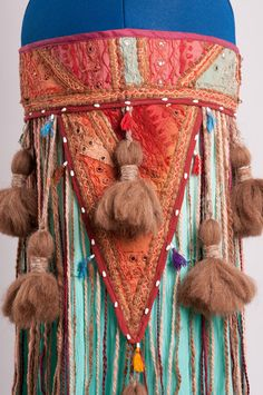 Plus Size Bellydance Tribal Tassel and String Belt in  burgundy/turquoise/browns/creams/peach. $295.00, via Etsy.