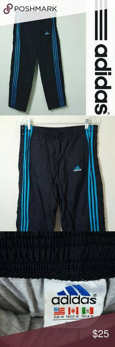Men's Adidas warm up pants Medium In excellent condition   Men's Adidas warm up pants  Size medium. Black and blue. Lined inside. Button down sides.  Offers welcome. Adidas Pants