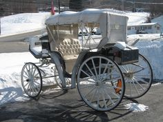 A snow-covered carriage! Coal heaters and thick blankets were a must for rides like this!