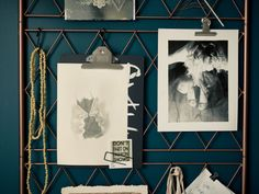 A DIY metal wire inspiration board hanging by leather straps on a wall