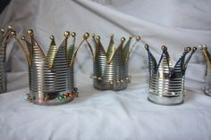 Tin Crowns in metals  with Tin cans Tin Repurposed Recycled crowns aluminum ..... this is not a tutorial.  It's just an idea.  For some reason, this reminds me of the Sesame Street animation King of 8 ...... http://youtu.be/9GOqM18Bhhg