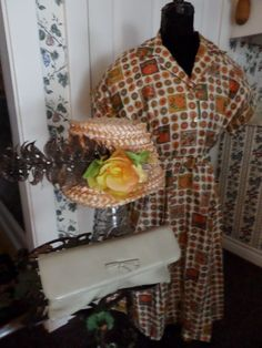 1950 cotton dress ,clutch purse and an afternoon tea hat.
