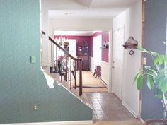 Open staircase reveal. They took out part of the wall to really open up the space. Omg!!! Wonder if we could do this. So similar to our entrance! What a difference!!