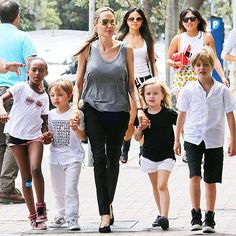 Angelina Jolie takes a breather from directing her next film, Unbroken, in Australia to visit to a local bookstore Friday with her kids – Zahara, Knox, Vivienne and Shiloh on December 9, 2013.