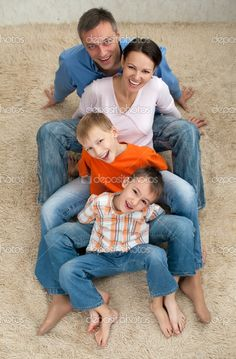 Family of four sitting on the carpet | Stock Photo © Alevtina Guzova #1127901