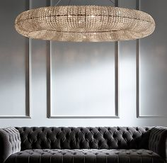 """RH's Crystal Halo Chandelier 41"""":Inspired by a stunning antique French chandelier from the 1930s, ours echoes the ingenuity of those designs. Over 44,000 faceted, hand-wrapped crystal glass beads wrap the steel frame to form a floating orb, suspended via a steel cable. The beadwork, reflecting and refracting the interior light, casts a warm glow."""