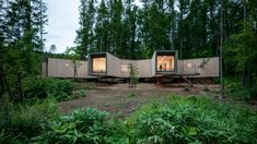 Tokyo studio Florian Busch Architects has designed a cedar-clad holiday home on stilts with rooms that branch out into the surrounding forest. Forest Floor, Forest House, Concrete Steps, Concrete Floors, Shade Screen, Timber House, Front Entrances, Polished Concrete, Large Windows