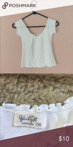 Cute ruffle brandy Melville off the shoulder tee Super cute off the shoulder crop to you by Brandy Melville with a lettuce cut hem.  Perfect for the summer time since it's lightweight and easy to pair with anything Brandy Melville Tops Crop Tops