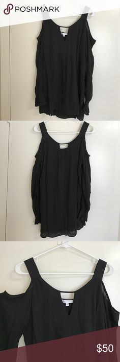 DR2 BLACK BLOUSE Black blouse. 100% Rayon. Cut outs on shoulder. Cut out in the center. No trades. Offers Allowed. DR2 Tops Blouses