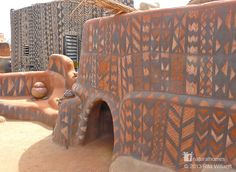 These are the earthen homes of the Gurunsi  in Burkina Faso. The men build the house and the women decorate the facades. All figures have a symbolic meaning. Round small houses 'dra' belong to young singles. The rectangular 'mangolo' with terrace belonging to young couples. The 'bilobées'  belonging to the older women and young children. Click on the picture to see a video on www.naturalhomes.org
