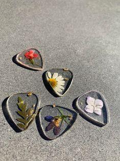 Floral resin guitar picks | Etsy Guitar Picks, Resin, My Husband Birthday, Handmade, Amazing Decor, Garden Items, Etsy, Household Items, Pretty Little
