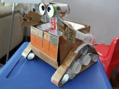 E robot made from recycled materials Wall E, Earth Day Projects, Projects For Kids, Crafts For Kids, Recycled Art Projects, Recycled Crafts, Diy Toys Recycled Materials, Vbs Crafts, Cardboard Crafts