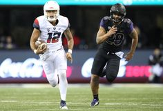 Photo Gallery: Football at Washington - The University of Arizona Official Athletic Site Sophomore quarterback Anu Solomon (12)