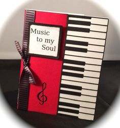 Piano Border 98808 Memory Box dies  Black cardstock, red cardstock, white card stock, Stampin Up ribbon.