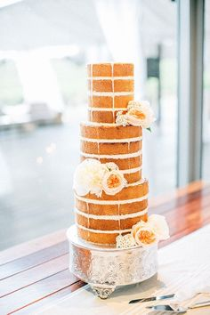 Such a beautiful naked, frosting-free wedding cake #nakedcake #weddingcake #cake #frostingfree #vintage