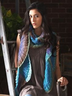 Gradual color changes and a mesmerizing scalloped motif make the Autumn Artisan Scarf a piece you'll be proud to call your own.