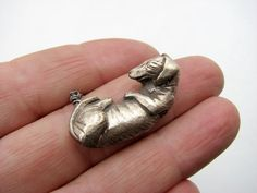 Silvery wiener dog sleeping - necklace. adorable!