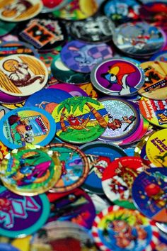 Pogs! - little cardboard circles with pictures on them made 90s kids so happy. Simple times.