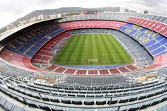 Camp Nou, Barcelona, Spain.  This is the ultimate stadium for futbol!  There is no place like it on Earth.