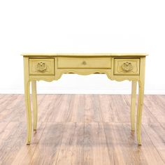 This shabby chic vanity is featured in a solid wood with a distressed cream pale yellow paint. This desk vanity is in good condition with 2 drawers, a lift up mirror with storage and delicate curved details. Perfect for storing makeup and accessories! #shabbychic #dressers #vanitydresser #sandiegovintage #vintagefurniture