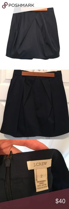 J. Crew navy bubble skirt Worn once. EUC. Adorable J. Crew navy bubble skirt. Can be worn high- or low-waisted depending on fit. Pleated on front and back. A preppy addition to any closet! J. Crew Skirts High Low